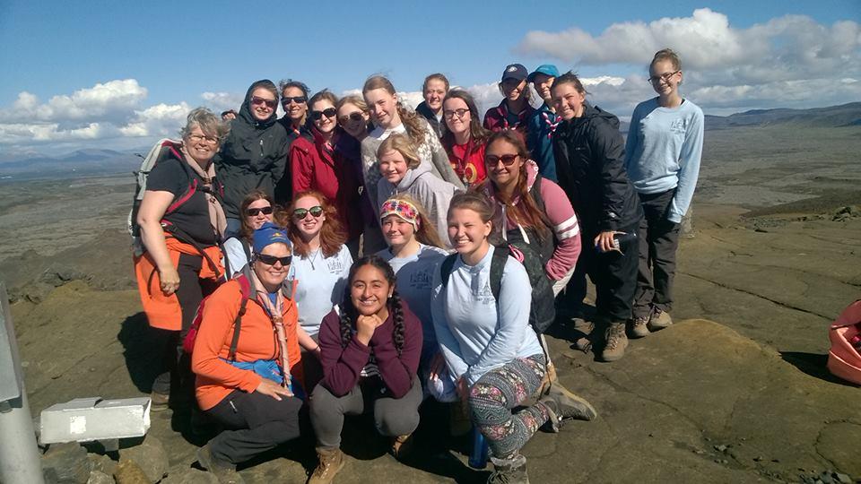 Travel troop group photo on top of helgafell